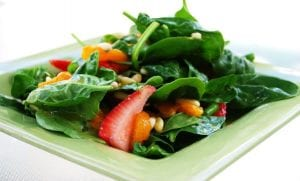 Spinach Salad* Baby spinach topped with mandarin oranges, strawberries, red onion, and almonds served with poppy seed dressing