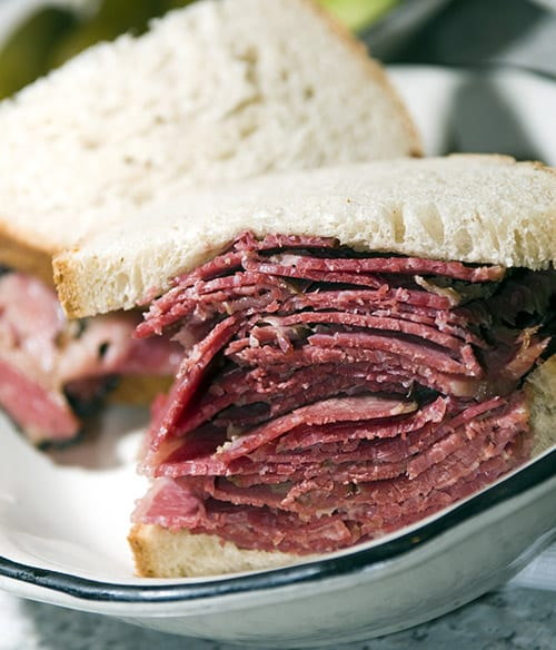 corned beef pastrami side by side sandwich rye bread kosher jewish delicatessen new york