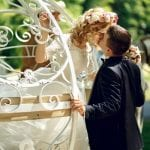 Romantic fairy-tale wedding couple bride and groom kissing=